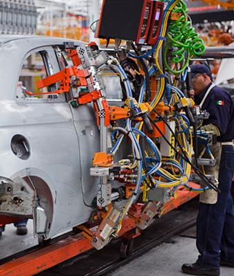 Robots work alongside humans at Chrysler Group's Toluca Assembly Plant in Mexico.